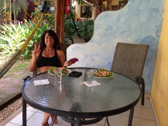 Barb enjoying a fresh salmon salad with fresh organic salsa